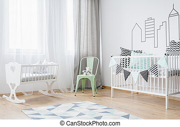 Bright baby room interior with wooden floor