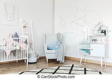 Bright baby's room with armchair