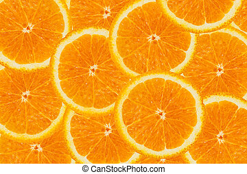 Bright background made of oranges slices.