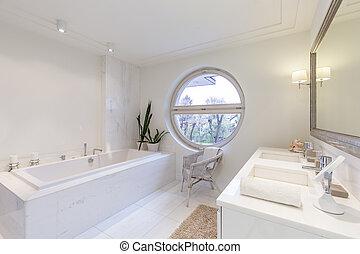 Bright bathroom with round window