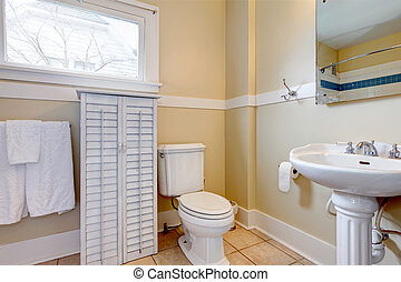 Bright bathroom with white wood cabinet