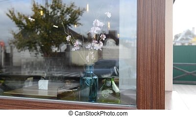 bright beautiful flowers in a vase on the window