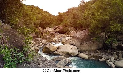Bright beautiful video with a group of small picturesque waterfalls. Vietnam. Nha Trang