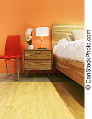 Bright bedroom in orange tones