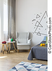 Bright bedroom with cosy armchair