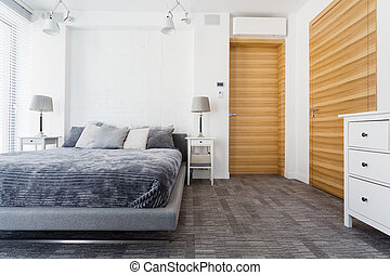 Bright bedroom with king-size bed