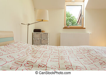 Bright bedroom with small window