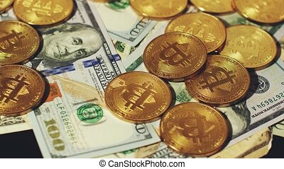Bright bitcoins with dollars - Close-up view of shiny gold...
