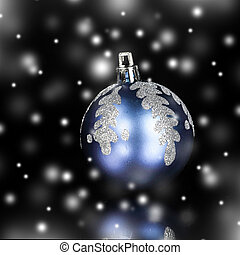 bright blue Christmas ball on a black background.