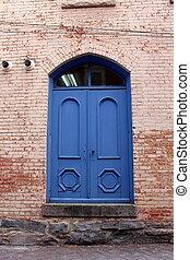 Bright blue doors in red brick