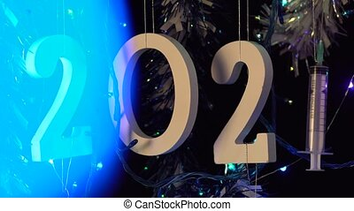 Bright Blue Light Glowing On 2021 Backdrop With Syringe, Hanging With Garlands
