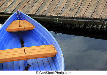 Bright blue row boat at dock