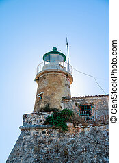 Bright blue sky with cirrus clouds and a small lighthouse on the highest point of the fortress. Old Fort. Corfu. Greece.