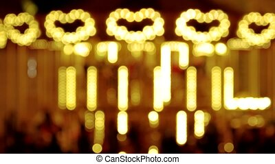Bright blurred carousel. Lights shaped heart.