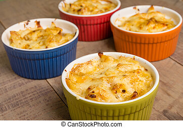 Bright bowls of baked macaroni and cheese - Bowls of baked...