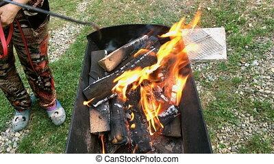 Bright burning hot coal in a grill, in a fire.