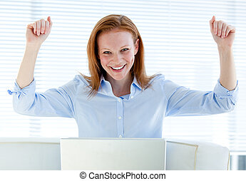 Bright business woman punching the air