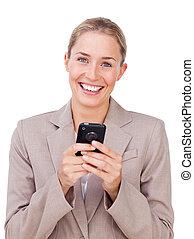 Bright businesswoman sending a text