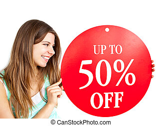 "Bright caucasian woman holding a ""up to 50% off"" red banner ..."