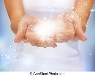 magic twinkles on female hands - bright closeup picture of ...