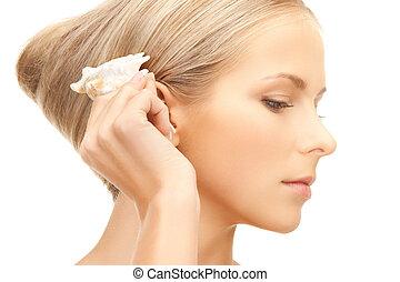 beautiful woman with seashell