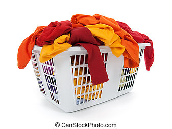 Bright clothes in laundry basket. Red, orange, yellow.
