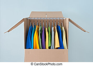 Bright clothing in a wardrobe box for easy moving - Bright...