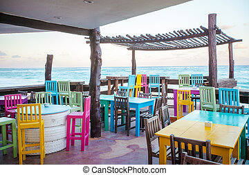 Bright colored bar-restaurant on the white sandy beach in...