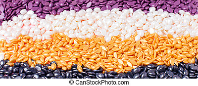 Bright colored granules. Abstract beautiful background. Granules for hair removal. Vivid colorful gold, black, white, purple pearl Wallpaper. Vibrant. Waxing wax. Spa salon banner