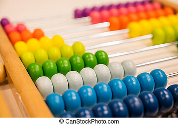Bright colored hand abacus. Children's wooden toy for the study of arithmetic.