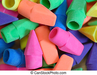 bright colored pencil eraser tops stacked up