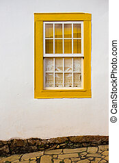 bright colored window - bright yellow wooden window in the...