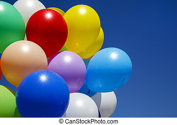 bright, colorful balls, against the blue sky