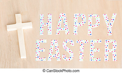 Bright colorful Happy Easter text and wooden cross and background. Copy space.