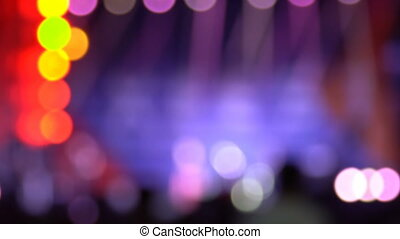 Bright colorful lighting on the stage in the defocus