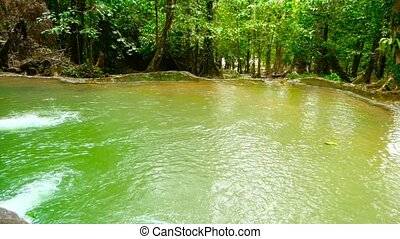 Bright colorfull natural pool in exotic rainforest. Tropical...
