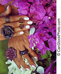 bright colorfull shot of african tanned hands with manicure...