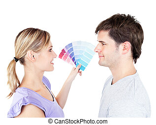 Bright couple choosing color for a room