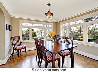 Bright dining room with wooden table set