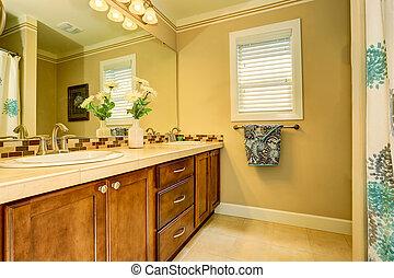Bright elegant bathroom interior with fresh flowers
