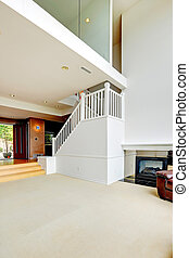 Bright empty house interior with loft