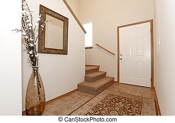Bright entrance hall - Light wall entrance hall with a rug....