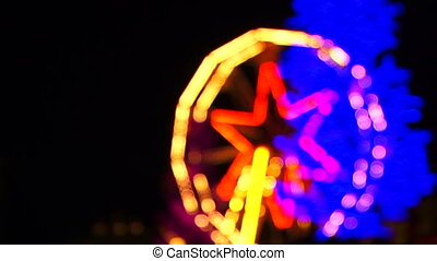 Bright Ferris Wheel With  Illumination Spinning At Night