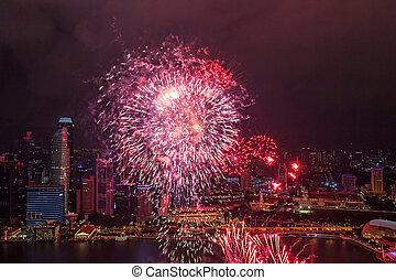 Bright fireworks on the promenade Marina Bay, Singapore.