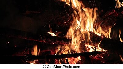 bright flaming of fire and hot wood at night.