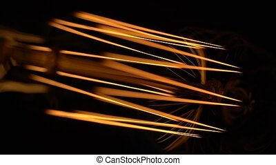 Bright flashes of an old lamp - Macro shot of powerful...