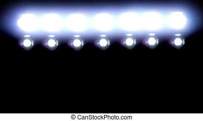 Bright Floodlights Flashing on Black between each clip.