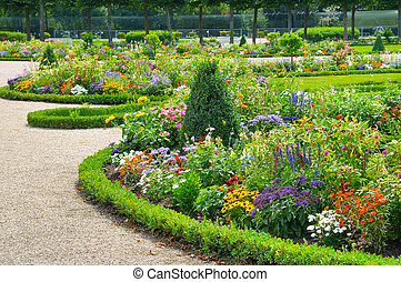 Bright flower bed in summer park.