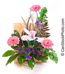 Bright flower bouquet in a basket isolated on white