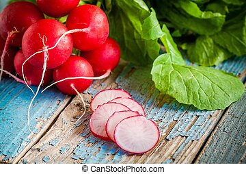 bright fresh organic radishes with slices